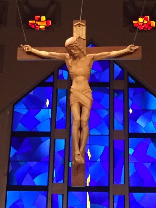Photo of recently lighted Crucifix above Church altar