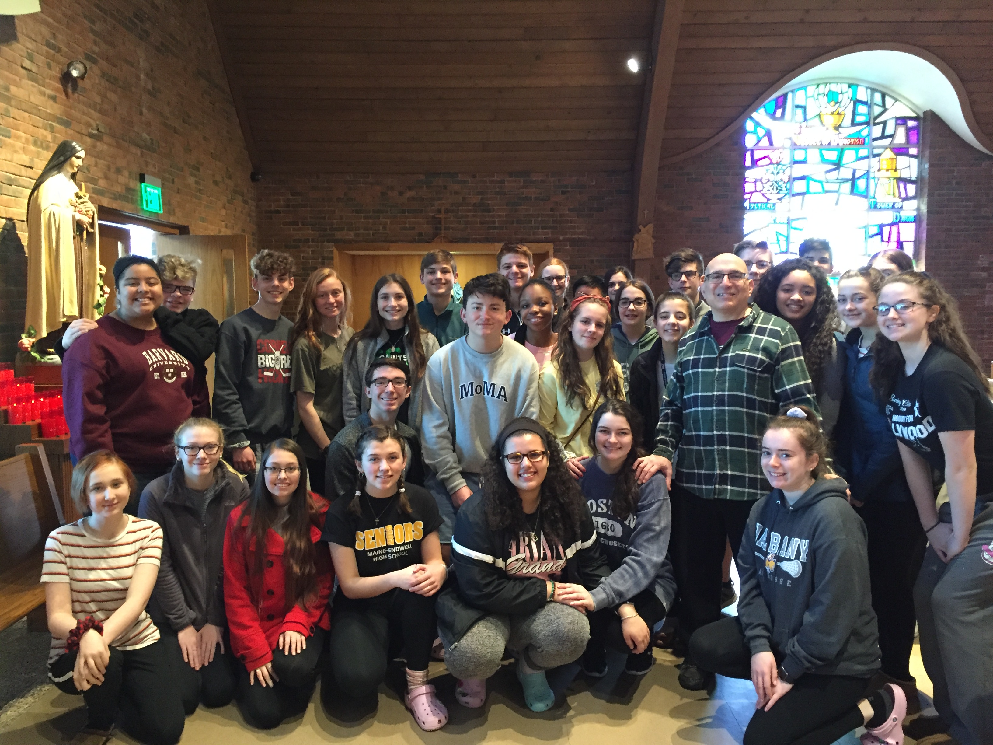 Students, teachers and parent chaperones from Seton Catholic Central High School attend 9:00 am Mass on Mar 31st,2019 at Our Lady's before heading home to Binghamton NY. They won the Choral Competition at the Boston International Music Festival.